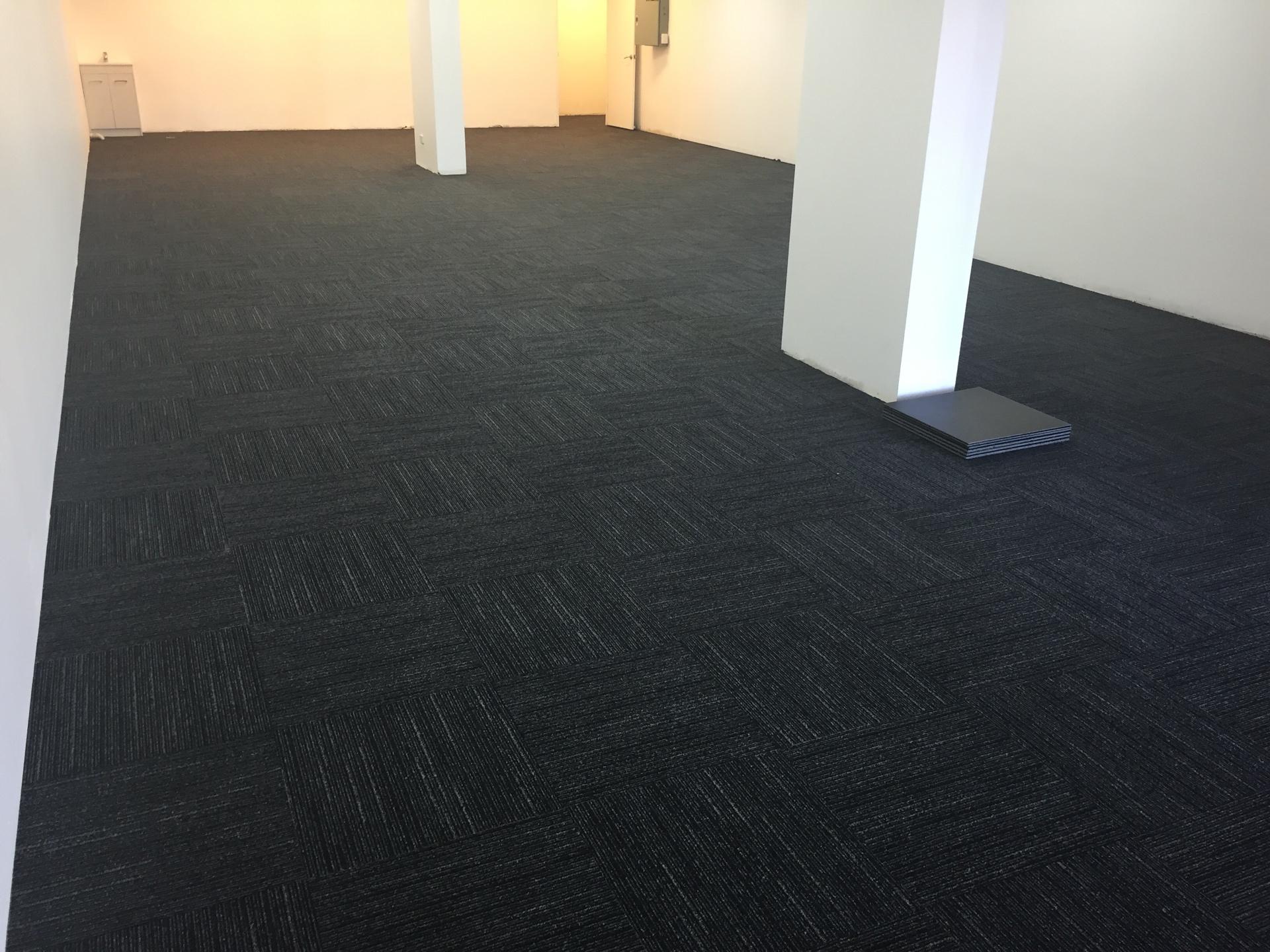 Laying carpet tiles on concrete floor